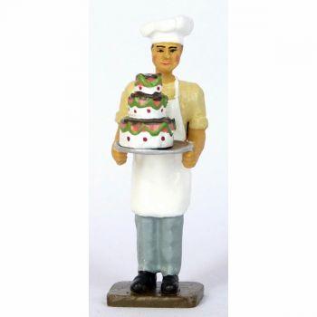 le Pâtissier avec gâteau à étages