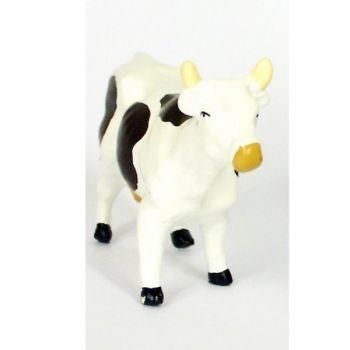 Vache blanche et noire, debout