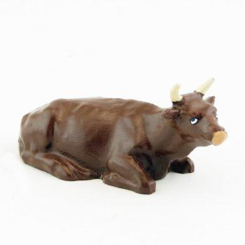 Vache marron (alezan) couchée