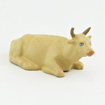 Vache beige couchée