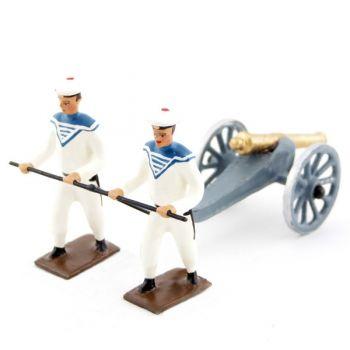 2 marins blancs tirant un canon de marine