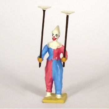 clown jonglant avec assiettes