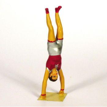 équilibriste faisant le poirier