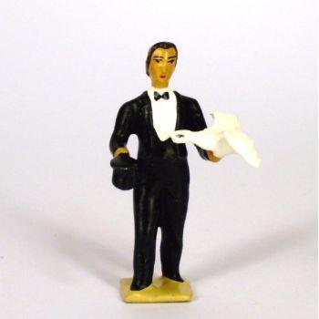 magicien en costume noir, sortant une colombe de son chapeau